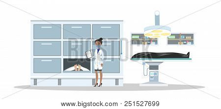 Morgue Interior. Dead Bodies In The Mortuary. Female Morgue Worker Standing With Clipboard And Looki