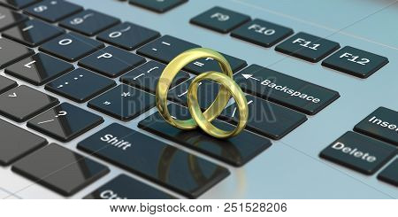 Online Dating. Pair Of Golden Wedding Rings Isolated On Computer Laptop Keyboard, 3d Illustration