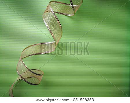 Curly golden ribbon
