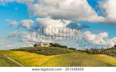 Medieval Farm Near San Gimignano With Vineyard In Autumn