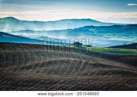 Cold Morning Over Tuscan Fields In The Early Autumn