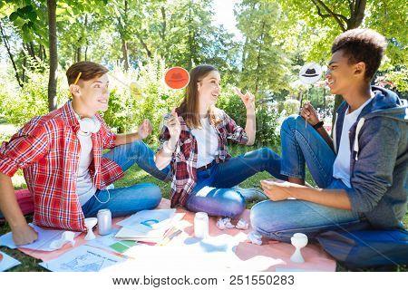 Progressive Postgraduates. Modern Progressive Postgraduates Having Brainstorming Spending Time In Na