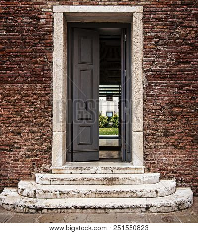 Steps To Open Door, Doorway In Old Brick Wall. Concept: Way To The Future, New Opportunities