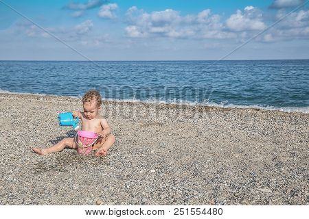 Family Vacation On The Beach On Summer Holidays. Concept Of Summer Family Vacation. Space For Text.