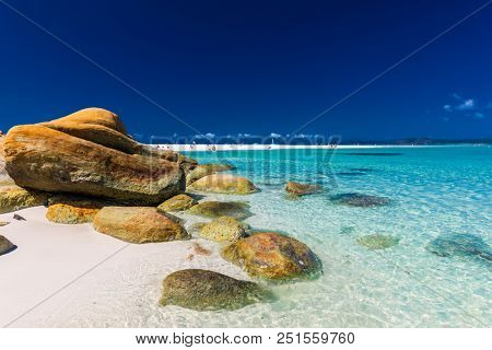 Rocks on amazing Whitehaven Beach with white sand in the Whitsunday Islands, Queensland, Australia