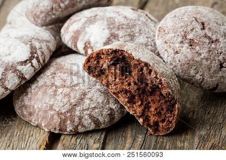 Heap Of Chocolate Cakes On Wooden Background