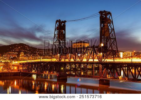 Traffic Light Trails On Steel Bridge Over Willamette River In Downtown Portland Oregon During Blue H