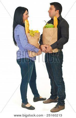 Full Length Of Talking  Couple At Shopping