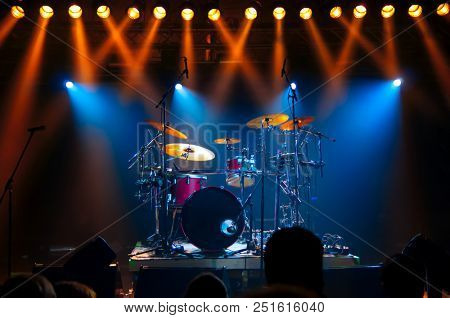 Drum Set on stage, illuminated by stage lights