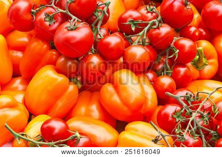 close up of red abd yellow pepper and tomatoes