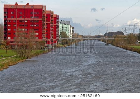 Red apartments along a canal