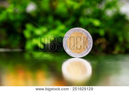 Two Euro Coin Closeup On Silver And Green Background.