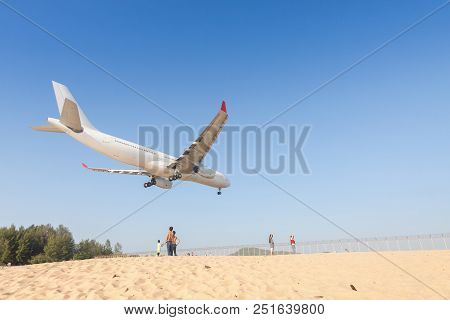 Airplane Is Landing At Phuket Airport , Thailand