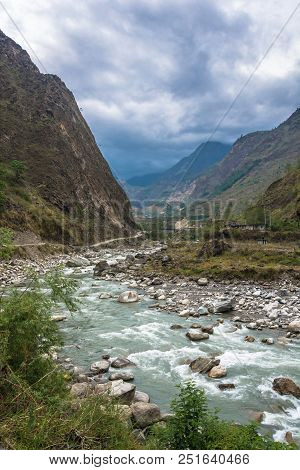 A Small Mountain River In The Himalayas On A Cloudy Spring Day, Nepal.