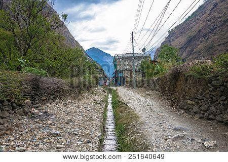 Tatopani, Nepal-09.04.2018: Narrow Village Street In Mountain Village 9 April 2018 Tatopani, Nepal.