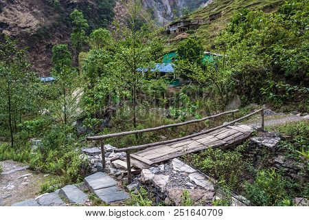 A Small Wooden Bridge On A Mountain Path In Nepal.