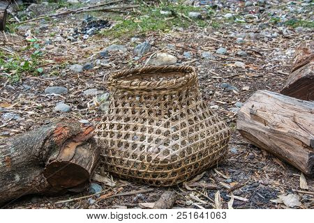 Large Wicker Basket With White Chicken Egg On Straw.
