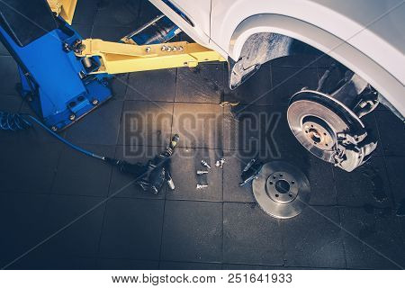 Vehicle Brake Discs And Pads Replacing. Car On The Lift In The Auto Service.