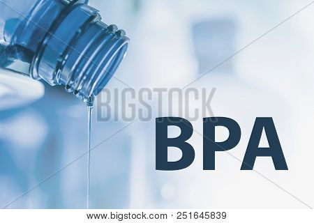 Plastic Bottle And Liquid Stream. Bisphenol, Bpa Free Plastic Photo.