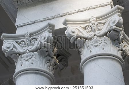 Classical Corinthian style capital on top of marble column white poster