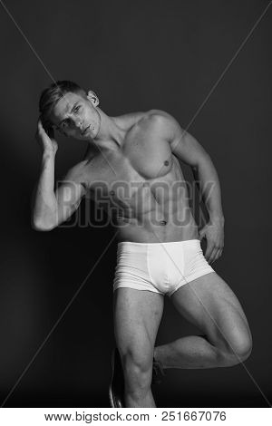 Sports, Clothes And Healthy Lifestyle Concept. Guy Or Sexy Macho With Strong Muscles Stands On One L