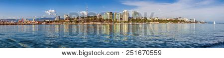 Sochi, Russia - February 23, 2016: Panoramic View Of The City From The Sea. Reflection In Water Comp