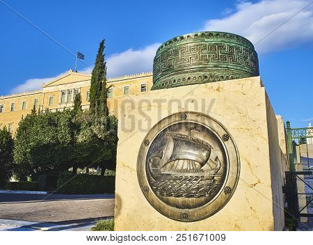 Athens, Greece - June 29, 2018. A Bronze Shield Representing A Trireme, Classic Greek Ship, On The M