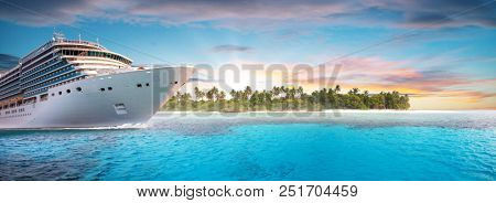 Luxury cruise boat with tropical island on background. Concept of long-distance cruise among the continents.