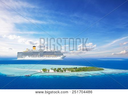 Luxury cruise boat with tropical island, aerial view. Concept of long-distance cruise among the continents.