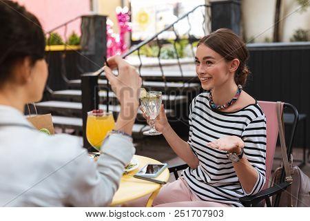 46bdcca8b6730 ... Lunch Break. Beautiful Businesswoman Spending Her Lunch Break With  Sister On Nice Summer Terrace clearance  Mom s feet in Flip Flop Sandals ...