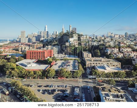 Aerial view Embarcadero boulevard and Telegraph Hill neighborhood from Pier 39 at sunset. Coit Tower is located at the top of the hill, San Francisco, California, USA poster