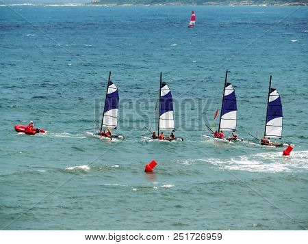 Cannes, France - July 2, 2018: Sailing Catamarans In The Mediterranean Sea. Unidentified People Are