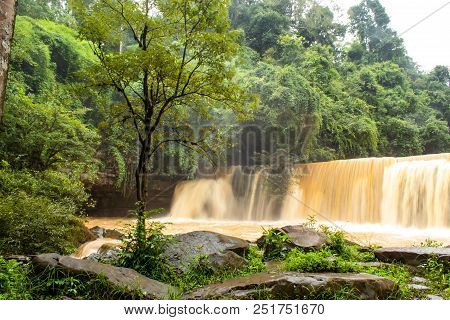 Waterfalls During The Rainy Season The Red Soil And Water Is Flowing At Si Dit Waterfall , Phetchabu