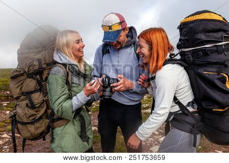 Travel Lifestyle And Survival Concept Rear View. Hiking Man And Women With Backpack Enjoys A Hike  A