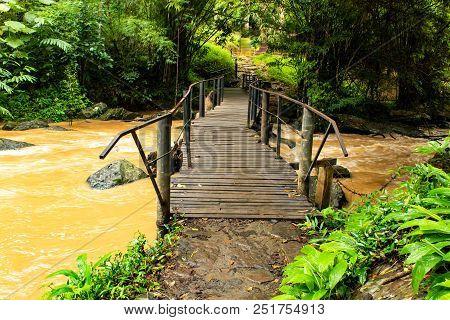 Wooden Bridge Crossing The Brook At Si Dit Waterfall , Phetchabun In Thailand.