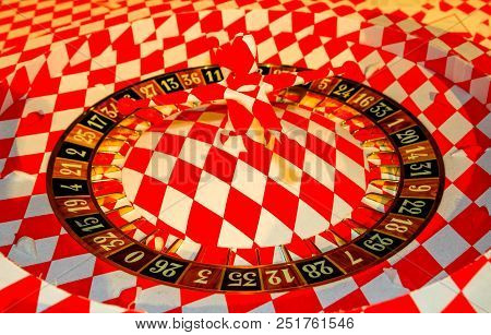 Roulette Wheel On Red And White Background In Montecarlo, Monaco.