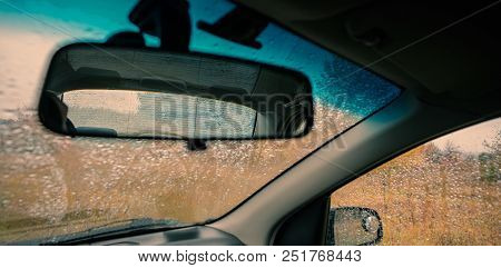 Rear View Mirror Of A Car On A Background Of Glass In Drops Of Autumn Rain. Web Banner. Element Of D