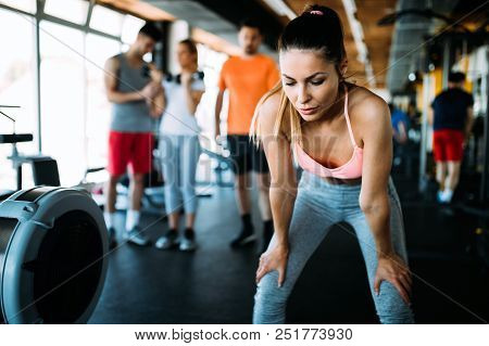 Portrait Of Tired Woman Having Rest After Workout. Tired And Exhausted Female Athlete In Gym
