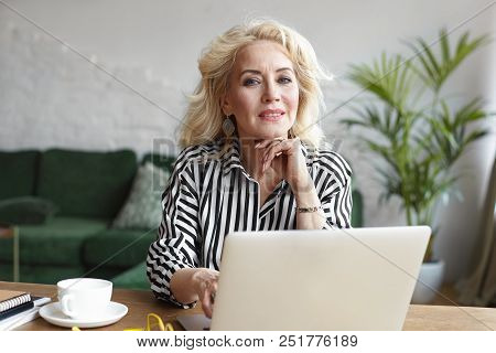 People, Age, Job And Occupation Concept. Attractive Confident Female On Retirement Wearing Stylish S