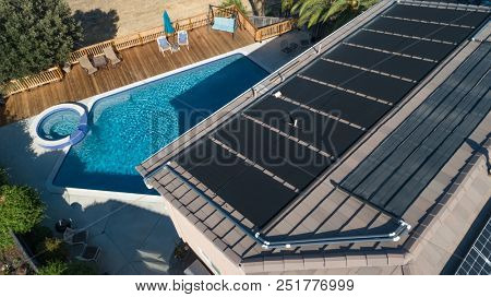 Thermal Solar Panels Installed on the Roof of a Large House.