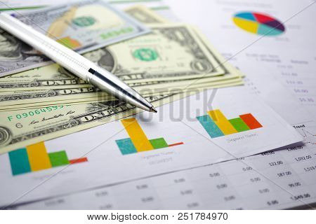 Us Dollar Banknotes On Charts Graphs Spreadsheet Paper. Financial Development, Banking Account, Stat