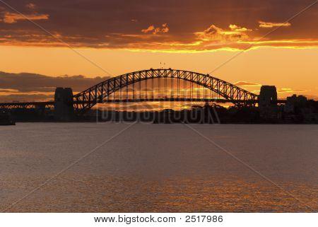 Golden Sunset Behind Sydney Harbor Bridge