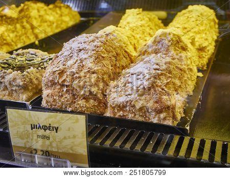 Athens, Greece - June 29, 2018. Galaktoboureko, Typical Greek Sweet In A Storefront Of A Greek Pastr