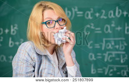 Thirst of knowledge. Hungry for knowledge. She ready to eat her paperwork. Woman teacher eats crumpled piece of paper chalkboard background. Teacher eats piece of paper with mistake failed test. poster
