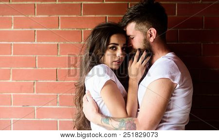 Moments Of Intimacy. Couple In Love Hugs Brick Wall Background. Couple Find Place To Be Alone. Coupl