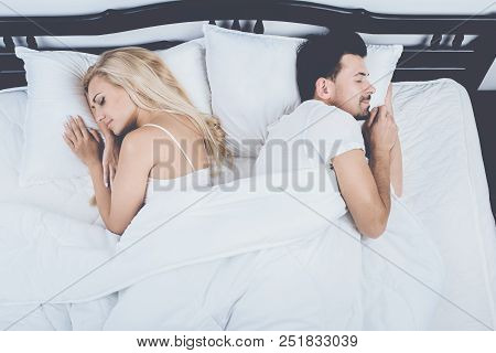 Top View Of Young Couple Sleeping In Bed At Home. Healthy Sleep Concept Snore, Sleep, Apnea, Couple