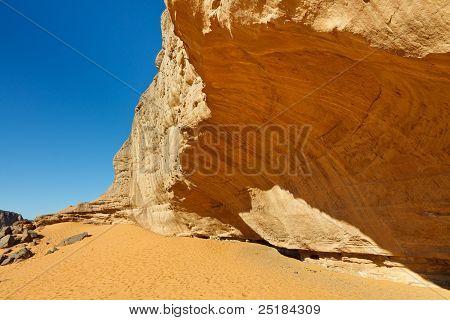 Massive Rock Face In The Sahara Desert
