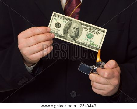 Man burnning the money business concept background poster