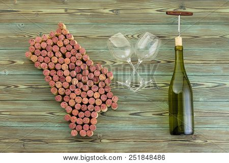 Map Of Napa Valley Made Of Used Red Wine Bottle Corks Arranged On Rustic Wood With Crossed Empty Win