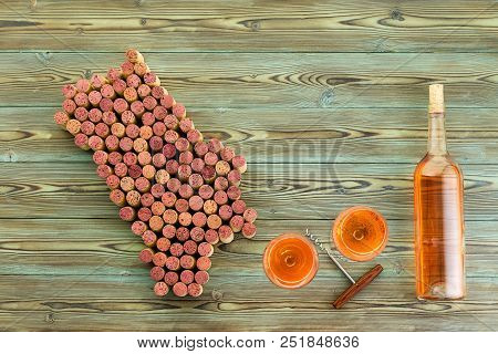Bottle And Glasses Of Wine And Corkscrew With Napa Valley Map Formed Of Used Stained Red Wine Corks